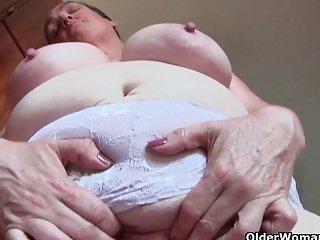 Busty grandma in nurse uniform and stockings