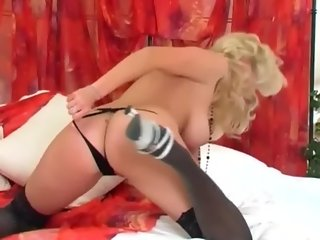 Blonde masturbates in thigh highs and high heels