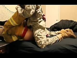Two men in uniform fuck
