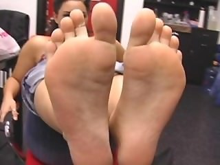 Feet of Mixed Race Girl Straight Out of Boots