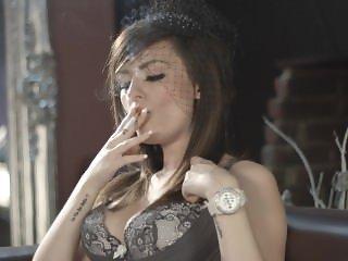 Charlotte Rose smoking corks 100s in lingerie side on