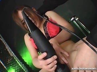 Sexy Oriental babe made to strip and orgasm with hitatchi magic wand