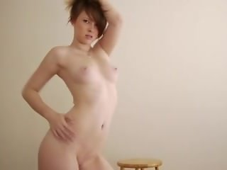 Wonderful striptease by cute redhead