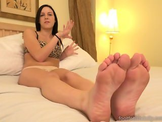 Slender Brunette Has Her Feet Worshipped with Cum Shot
