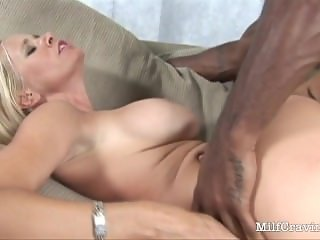 Horny black dude fucks a hot MILF on the sofa