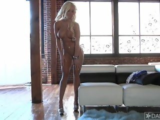 Blonde fitness girl in hot dress