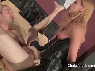 Strap on fucked by mistress in leather