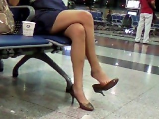 Mature Asian nice sexy legs dangling in public