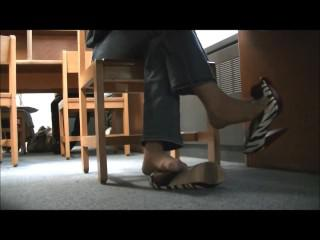 Candid Library Dangling in Zebra Pumps with Nylon Feet