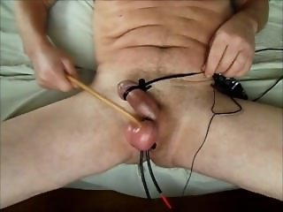 Caned balls wired for electro torture and beaten to hands free orgasm