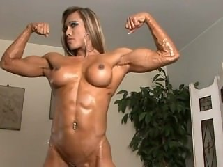 Thai muscle girl flexing