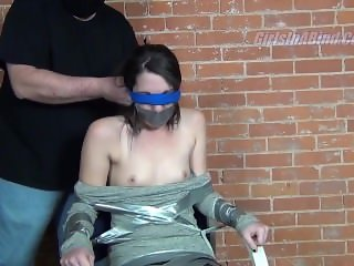 Brunette Tape Gagged