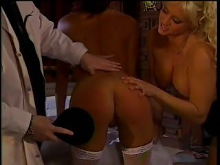 Horny doc From SEXDATEMILF.COM in spanking action with 2 big tit hotties