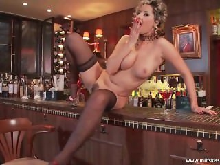 Stunning MILF gets horny in the bar