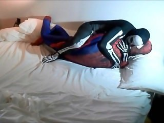 skeleton humps spiderman on his white bed