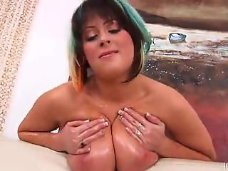 She enjoys playing with her jiggling natural tits