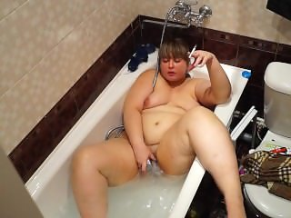 fat woman smokes in the bathroom and shower masturbating. hidden camera