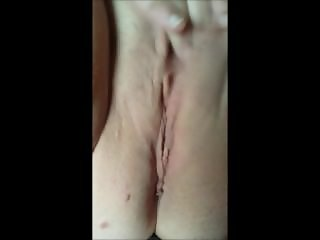 MILF playing with her shaved vagina
