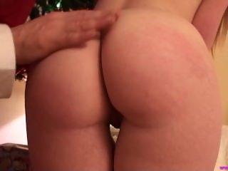 Naughty slut Ella Hughes spanked by Santa