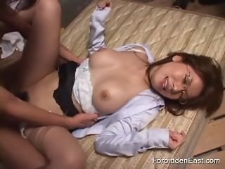 Oriental business woman gets her pussy pounded deep on the floor