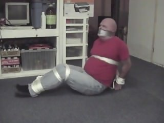 Chubby Man tied up and duct tape gagged
