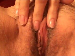 Horny grandma rubbing her hairy muff