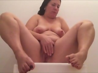 Chunky wife playing with her horny pussy