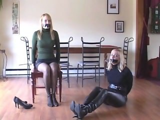 Bound gagged burglar in leather leggings
