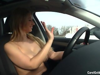 Boobs out while driving car