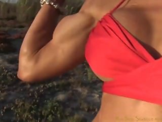 Rebecca fitness hard biceps and calves closeup