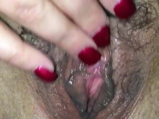 Rubbing out a juicy and hairy pussy