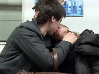 Couple Kissing In the Metro