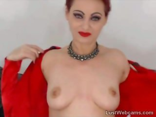 Redhead MILF fingers her pussy on webcam