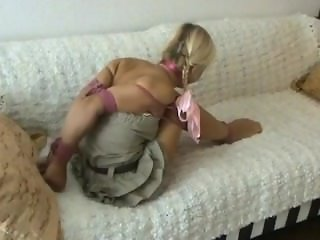 Petite blonde bound on sofa