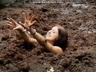 Handcuffed woman gets stuck in deep mud