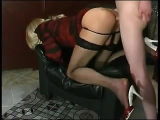 Pretty blonde crossdresser has fun with cock on chair