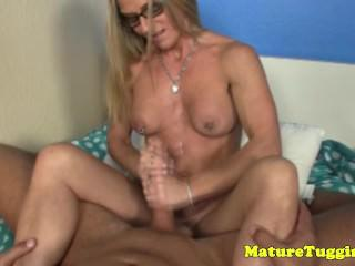 Jerking milf with nipplepiercings gets cumshot