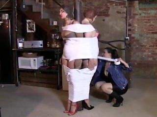 Two girls tape mummification and gag with wite duct tape by one girl