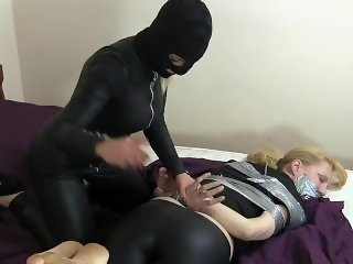 WOMEN TIED AND GAGGED WITH DUCT TAPE BY VILLAIN GIRL