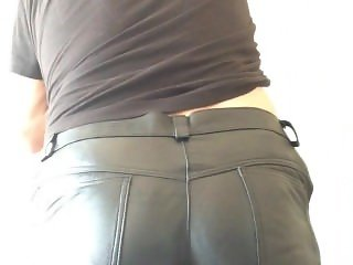caning on leather trousers and the bare bottom
