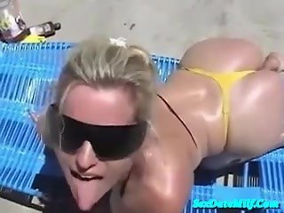 Blonde MILF gets a facial on the beach