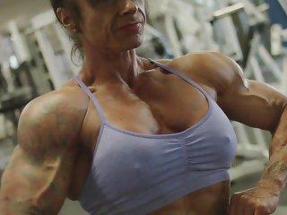 Female Muscle Flexing Hard