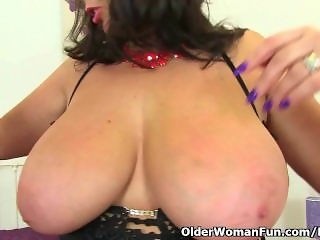 British milf Lulu Lush is wearing fishnet stockings and high heels
