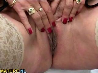 Redhead mature masturbates in lingerie