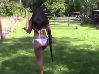 49 year old Farm Girl Shooting a shotgun in in her bikini!
