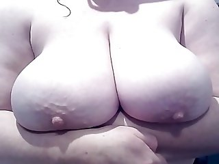 Busty big tit wife jiggles her massive tits