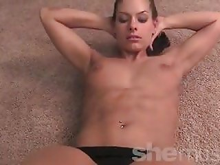 Fit Skylar Rene stretching, flexing and posing