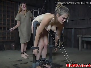 Restrained sub whipped while anally hooked