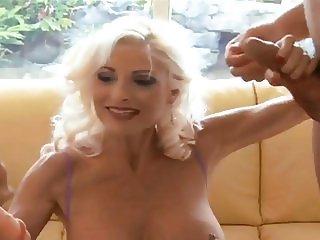 Blonde gilf takes on two cocks