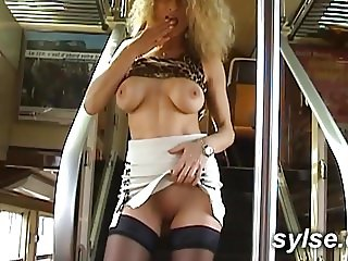 Young boy and french MILF in train